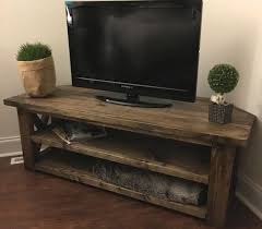 a rustic style corner tv stand