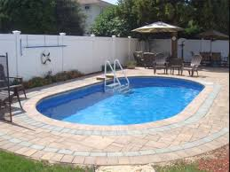 Semi Inground Pools for Your Magnificent Backyard: Modern Patio Red Bushes  Flowers White Fence Semi Inground Pools With White Permanent Fence