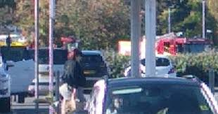 several fire engines are at the church langley way petrol station