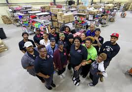 employees gather in the warehouse at the crayon case cosmetics in pearl river on thursday november 29 2018 photo by michael democker nola the
