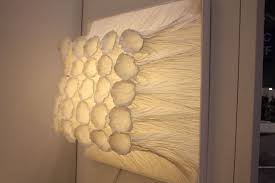 lighting from the ground. like flowers bursting forth from the ground flavia is a wall mounted light that almost lighting m