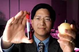 "John Todd Shan Wang. Holding a blood sample and a model of an electron with a magnetic pole to indicate its ""spin,"" Wang illustrates two applications of his ... - shanwang"