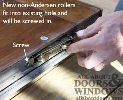 insert rollers into mortise taking care to make sure center is lined up with adjustment hole once rollers are aligned secure rollers by ing in
