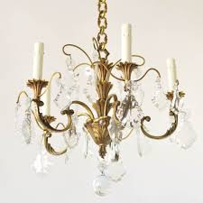 small vintage bronze chandelier with crystal prisms