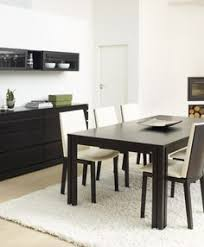 the wenge dining room offers leather chairs and a matching buffet