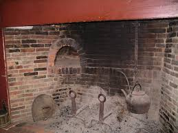 the fitch house also in sturbridge had a metal oven door seen on the floor on the right hand side next to the shiny reflective pan on the hearth floor