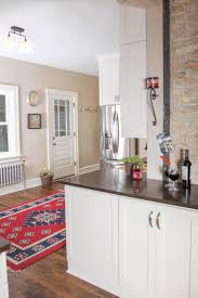 kitchen cabinets home office transitional: transitional kitchen white painted cabinetry with caesarstone countertop tops stainless steel appliances and hardwood flooring