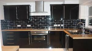 simple black subway tile kitchen backsplash