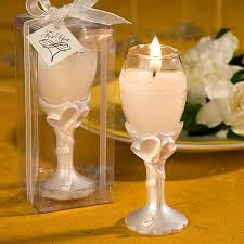a striking example of favors with true style and class these double heart design champagne flute candle holders are exceptional