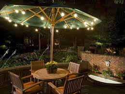 nice outdoor lighting ideas with offset patio umbrella costco and wooden dining furniture plus brick wall