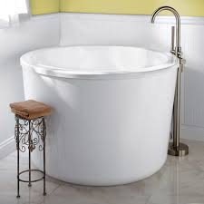 divine white rounded freestanding tubs with chrome stand faucet also wooden seater added iron base in small guest bathroom ideas