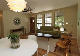mid century modern living room ideas glass pendant lamp white beadboard pan cream vinyl single seat sofa natural brick fireplace design storage drawers