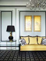 greg natale chic black yellow living room design with gray walls br accent table black geometric rug yellow black settee silk pillows white