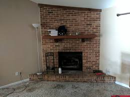 red brick fireplace in the living room fireplace