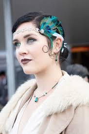 flapper hairstyles for long hair woman at goodwood revival with dark brown hair in a