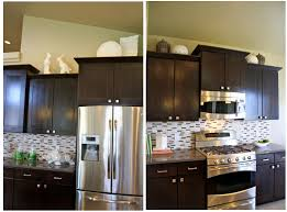 decorating above kitchen cabinets unique how to decorate kitchen cabinets shaweetnails modern decor photograph of decorating