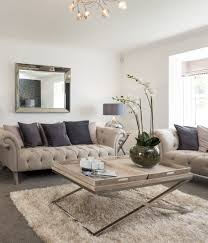 interior stylist suzanne webster chose a clic cream chesterfield sofa for the lounge plemented with a cream studded armchair and balanced by the soft