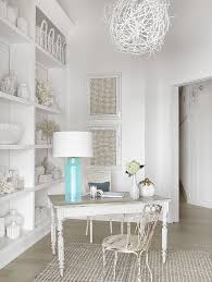 white cottage home office with catty corner whitewashed desk