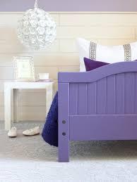 purple kids room with round rose chandelier