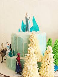 diy frozen birthday cake with figurines and elsa on mountain