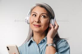 Image of adult woman with long white hair using cellphone and headphones  Stock Photo by vadymvdrobot