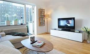 apartment modern living room apartment decoration white painted walls oval wooden table finished wood flooring