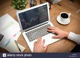 Broker Or Investor Analyzing Chart In Office Trading