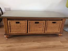 solid wood coffee table with 3 wicker storage baskets 50 l x 27 w x 18 h