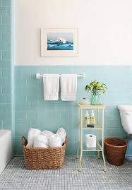 blue bathroom tile ideas: rue magazine pretty bathroom with aqua blue tiled half walls and bath surround the