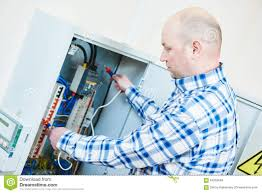 electrician works with electric meter tester in fuse box stock How A Fuse Box Works electrician works with electric meter tester in fuse box details how a fuse box works