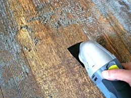 remove adhesive from wood floor how