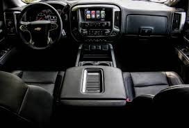 still beneath all of that heated leather and automatic assistance lies a work truck and a nice one at that with its spacious stow pockets and
