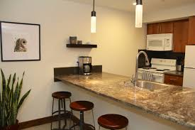 poured concrete countertops luxury bar beautiful modern kitchen lighting pendants yellow
