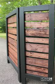 sugar sugar house made this amazing cedar outdoor garbage can enclosure for the front of their home you would never know what s behind it
