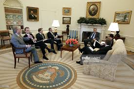 bush oval office. during a speech writers meeting in the oval office of white house us president bush l