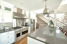 gray countertops with white cabinets west bay beach beach style kitchen dark gray granite white cabinets