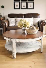 coffee table makeover from the painted hive stained top with white painted and distressed base