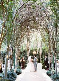 wedding ceremony down a tree lined aisle at hartley botanica in somis ca