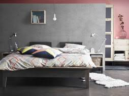 Modern bedroom design with NORNS bed in grey, bedside table and wardrobe  in untreated pine