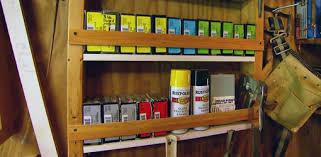 diy shelves in open stud wall in a work