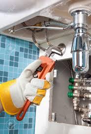 sanitary works plumbing work and sanitary engineering repairing a pipe under