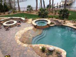 freeform pool and spa with concrete decking