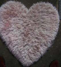next heart shaped rug pink excellent used condition 82x 78 cms approx