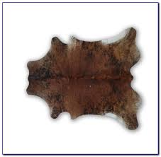 small faux cowhide rug rugs home design ideas small white cowhide rug