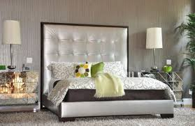 View in gallery Silver upholstered bed with a tall tufted headboard