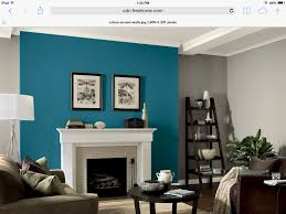 gray walls with teal fireplace accent wall