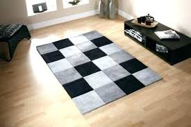 large black rug and white checd runner big fluffy red rugs for bedroom