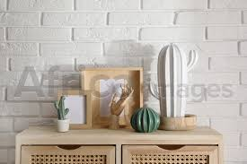 diffe accessories on wooden cabinet