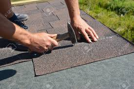 Asphalt Shingles Installation Roofer Contractor Hands Installing