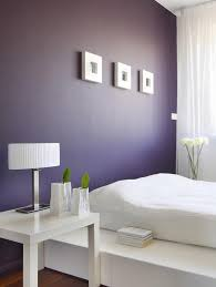wall painting in purple contrasted with white lacquered furniture bedroom paint color trends 2018